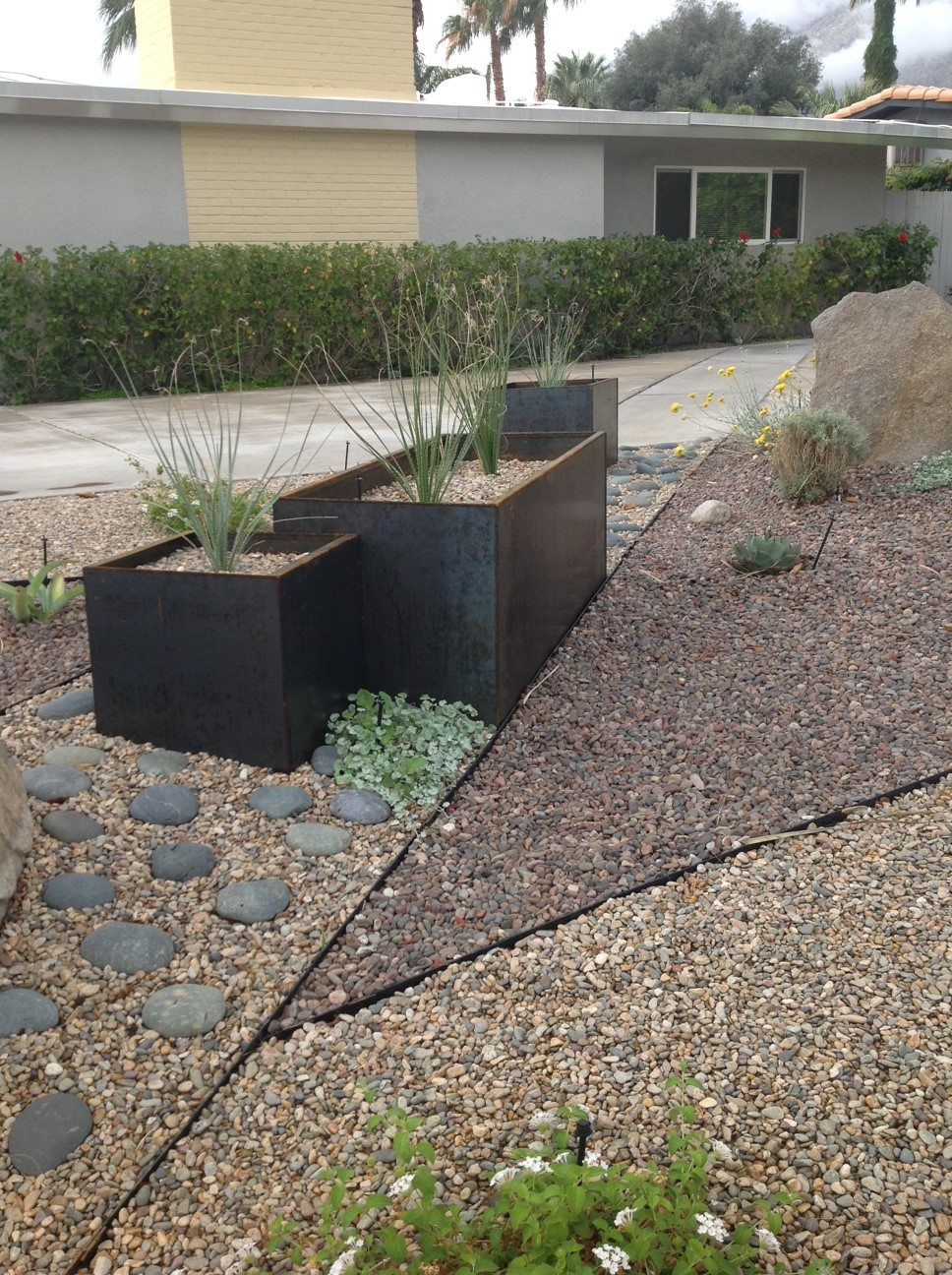corten steel planters in rock