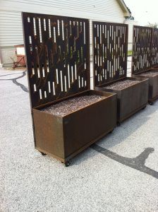 Planters with decorative laser cut corten steel privacy screens